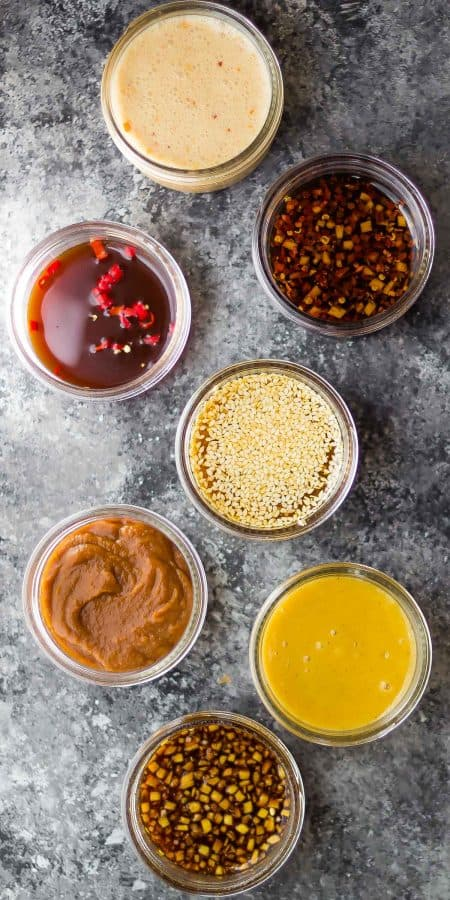 overhead shot of 7 easy stir fry sauces on gray background