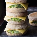 stack of three healthy breakfast sandwiches with one in background