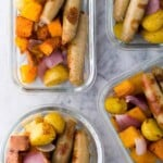 overhead shot of four glass meal prep containers with sausage breakfast bowls