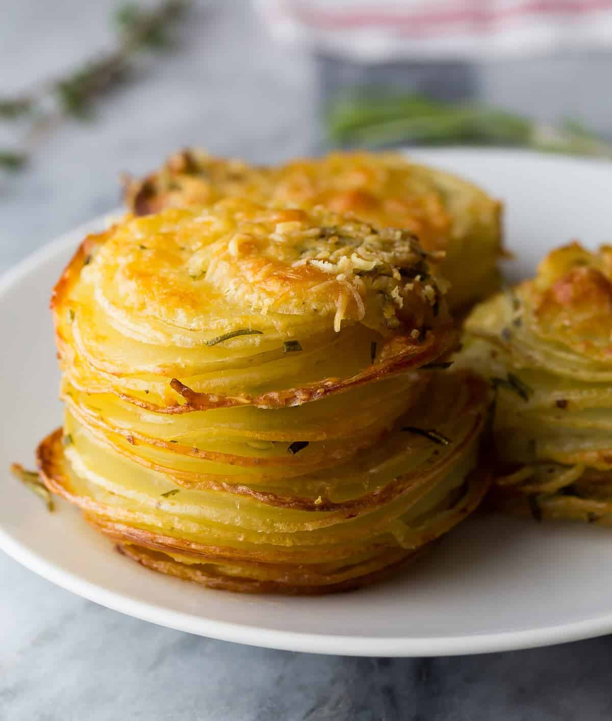 side view of herb and garlic potato stacks