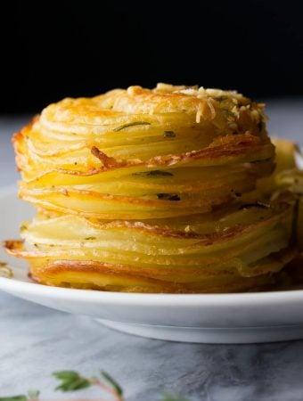 herb and garlic potato stacks on white plate