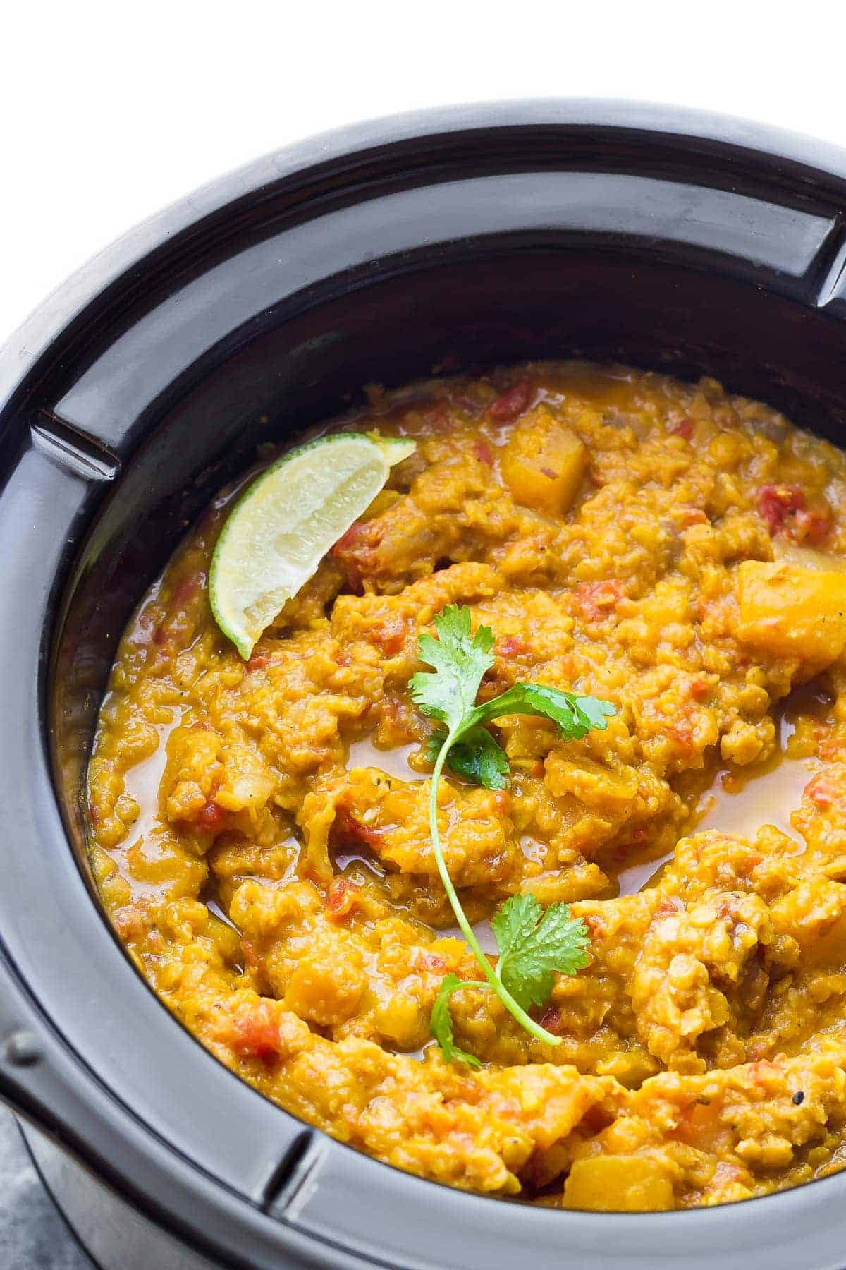 Slow Cooker Butternut Squash Lentil Curry. Vegan, gluten-free, dairy-free, and a super healthy lunch or dinner recipe!