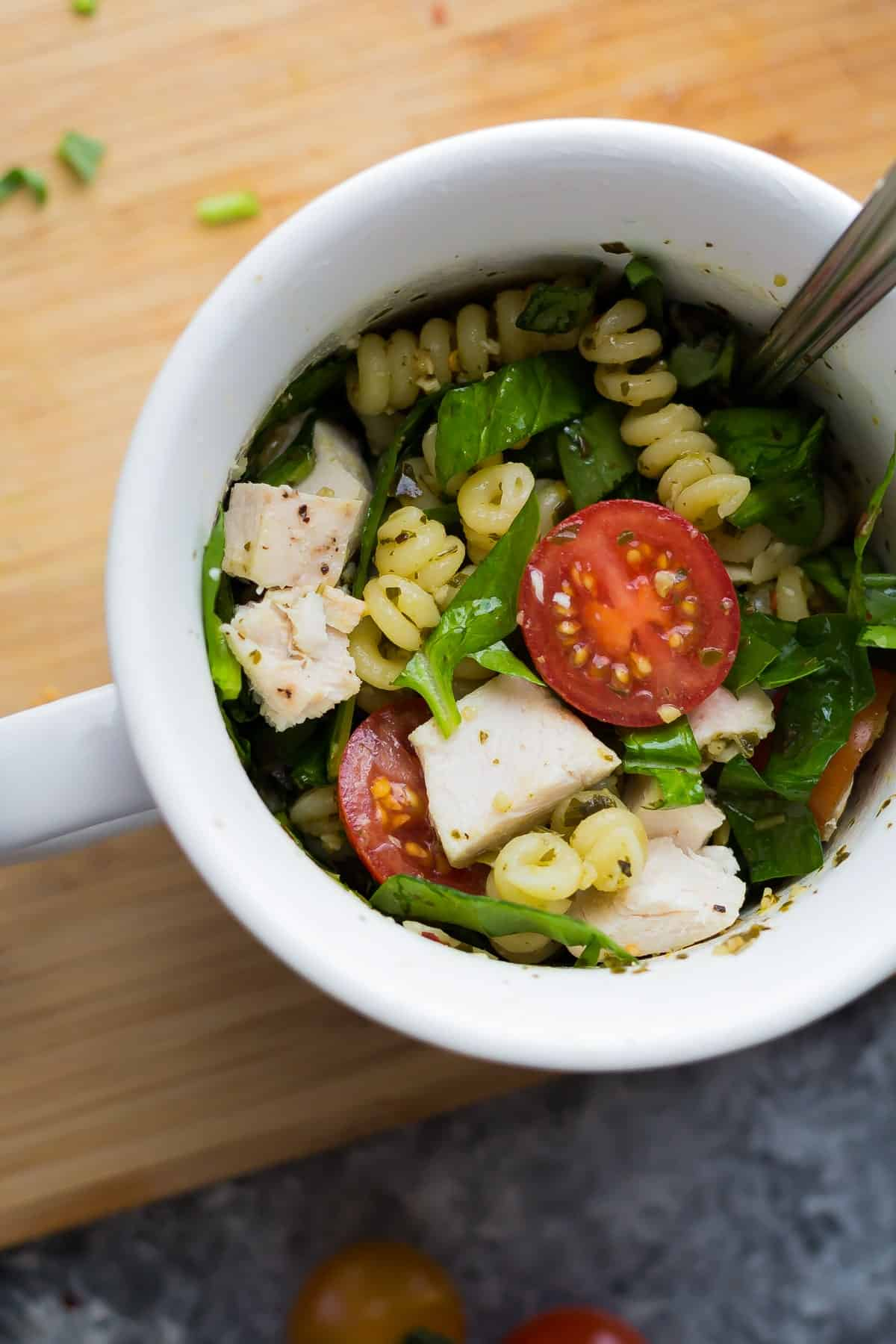This pesto chicken mug pasta cooks up in the microwave in under 10 minutes for an easy and healthy lunch, dinner for one, or a dorm room meal.