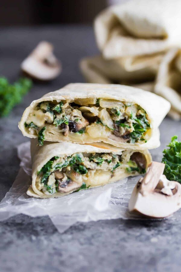 Time Saving Healthy Breakfast Recipes; kale feta breakfast burritos cut in half and stacked