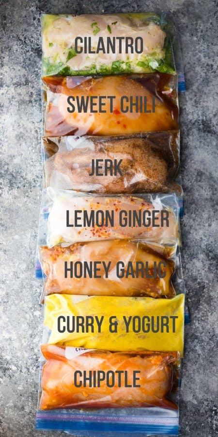 overhead shot of a variety of chicken marinades in freezer bags with labels