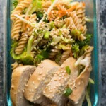 glass container with sesame chicken pasta salad lunch bowl