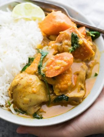plate of chicken and sweet potato curry with white rice
