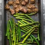 overhead shot of hoisin ginger steak asparagus and green beans on sheet pan
