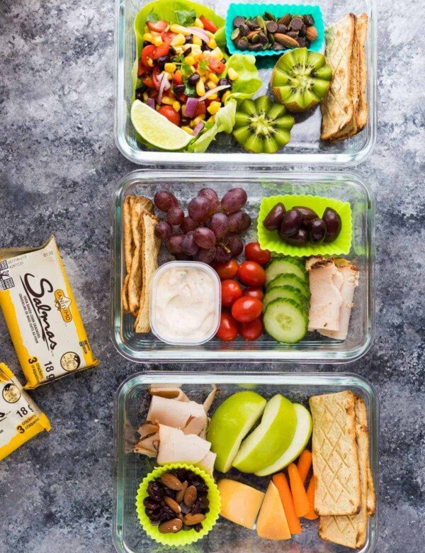 three meal prep bistro boxes on gray counter