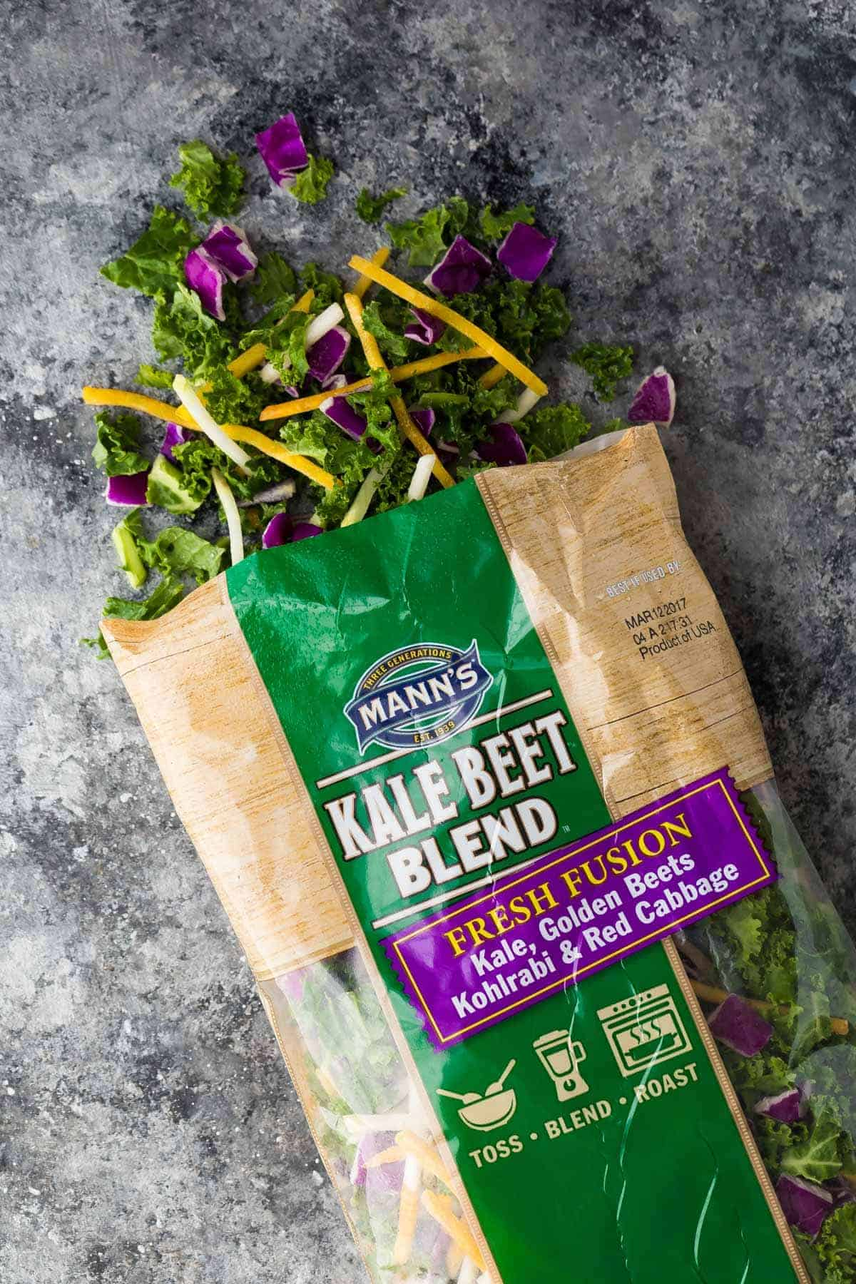 overhead view of a bag of Mann's Kale Beet Blend salad mix