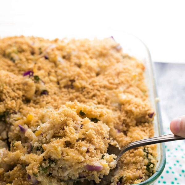 spoon in the mediterranean quinoa casserole on counter