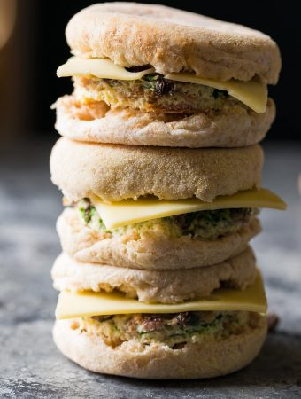 stack of three mushroom bacon swiss breakfast sandwiches