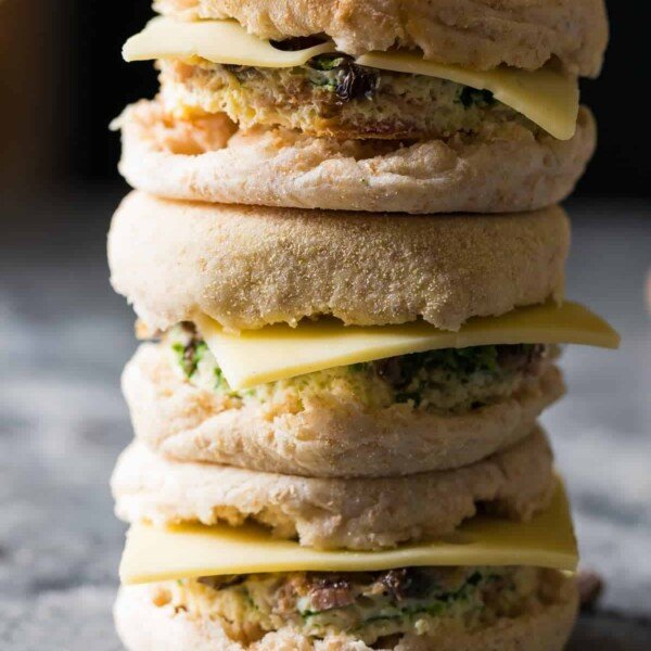 stack of three mushroom bacon swiss breakfast sandwiches