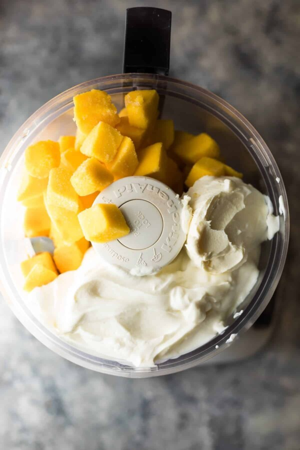 5 minute mango cheesecake frozen yogurt is a super fast treat to whip up with no refined sugars. Store them in the freezer for an easy, healthy snack or dessert.