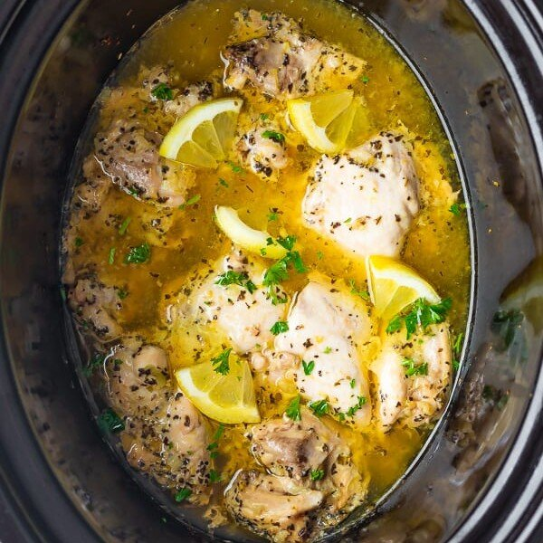 overhead shot of lemon garlic chicken thighs in slow cooker