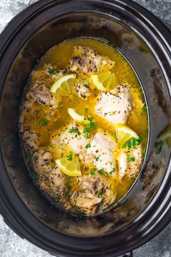 overhead view of slow cooker lemon garlic chicken in slow cooker