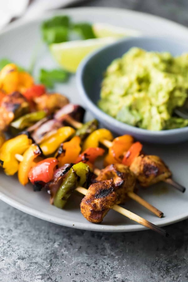 Freezer to grill fajita chicken skewers that can be assembled ahead, frozen, and go straight on the grill when you're ready to cook. An easy, healthy, and seriously delicious meal prep dinner recipe!