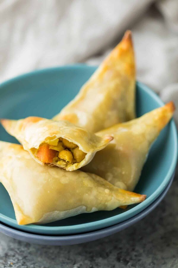 These healthy baked cauliflower chickpea samosas can be baked and stored in the freezer for an easy grab and go snack. These samosas use egg roll wrappers, which cuts out a huge amount of prep work.