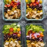 overhead shot of four glass meal prep containers filled with southwestern chopped chicken salad