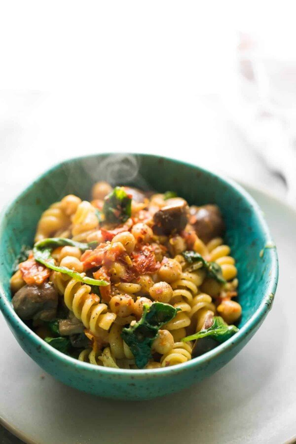 Sun dried tomato chickpea one pot pasta with mushrooms and spinach, which can be assembled up to 3 days ahead for a super easy meal prep dinner recipe!