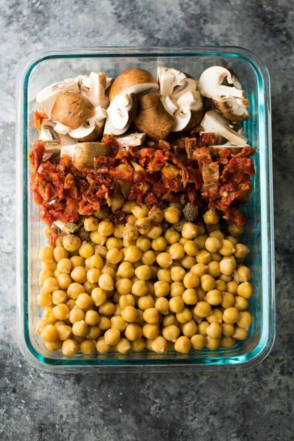 larger glass meal prep container filled with chickpea pasta ingredients