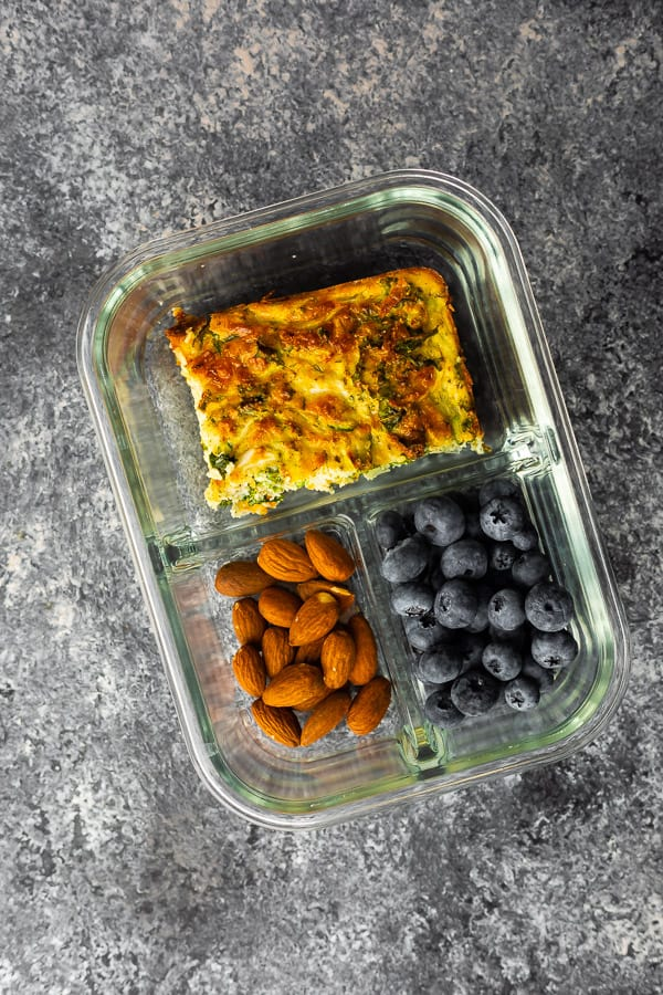 overhead view of herb & zucchini egg bake recipe in meal prep container