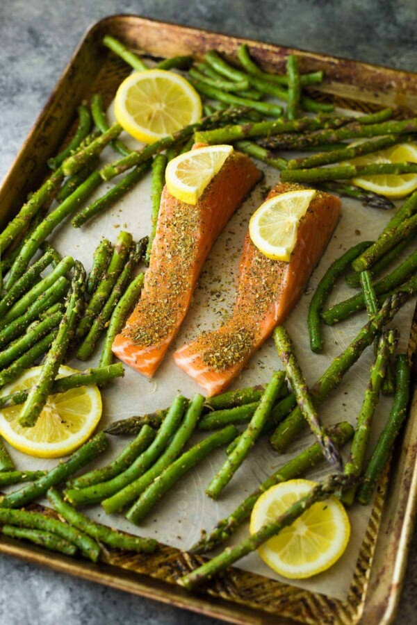 Lemon pepper sheet pan salmon with green beans, asparagus and lemon dill yogurt. You can prep this dish ahead and keep it in the fridge for up to 3 days before baking it.