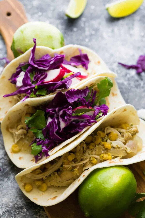 These slow cooker cilantro lime chicken tacos can be assembled ahead and stored in the freezer until you are ready to cook them up.  The cilantro lime chicken is versatile and is also great on salad, in wraps, pizza, you name it!