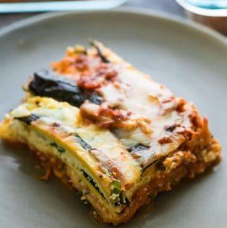 a piece of turkey zucchini lasagna on a gray plate