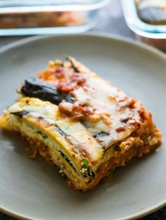 a piece of turkey zucchini lasagna on a gray plate