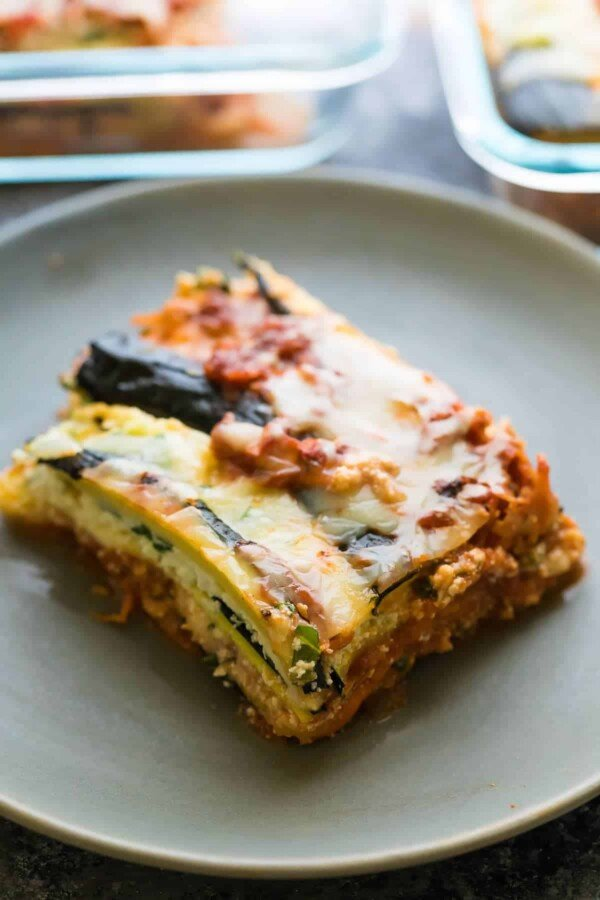This turkey zucchini noodle lasagna is the perfect low carb meal prep lunch or dinner! Make it ahead and freeze for when those lasagna cravings hit you. Turkey and vegetarian recipe options included.