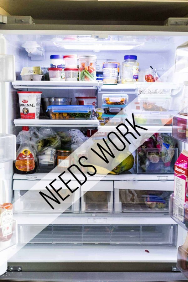 An open refrigerator filled with food and text saying needs work