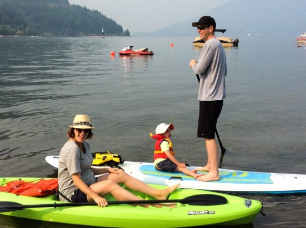 Denise and her family on paddleboards on the water