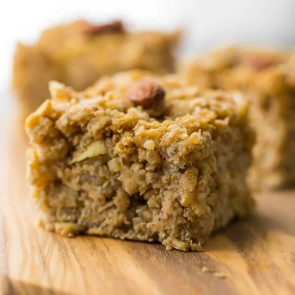 close up shot of apple quinoa breakfast bar on wood board