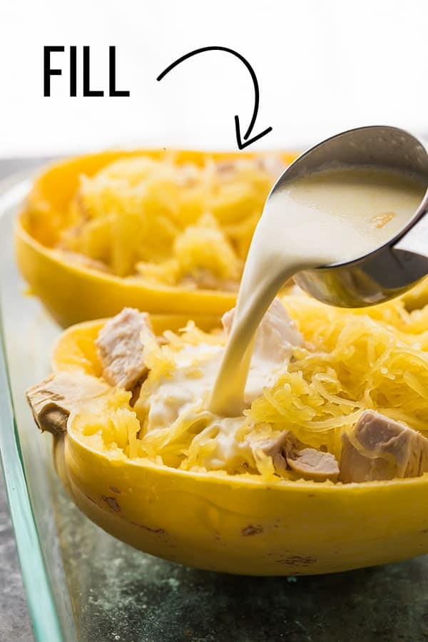 spaghetti squash being filled with lemon cream sauce