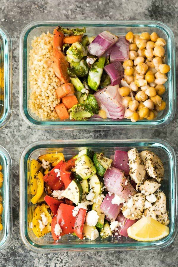 overhead view of Chickpea Buddha Bowls and Greek Chicken Wraps in glass meal prep containers