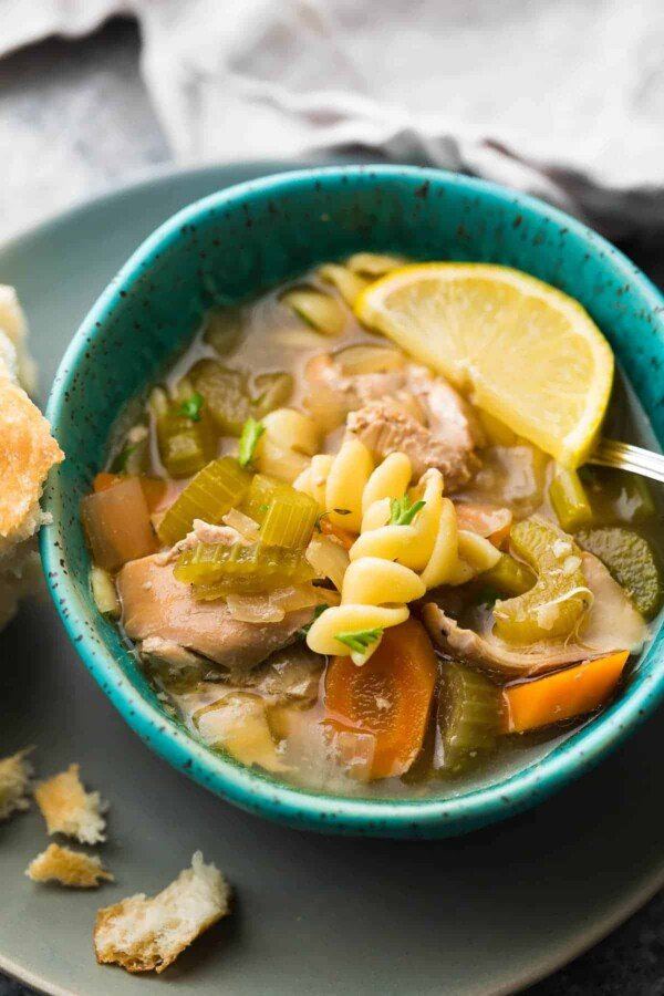 This slow cooker lemon sesame chicken noodle soup can be assembled ahead and stored in the fridge or freezer until you're ready to cook it up!  Perfect for cold and flu season: healthy, comforting and delicious.