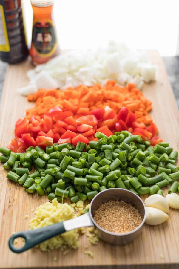 ingredients for fried rice on cutting board
