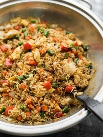 egg fried rice in a large silver bowl with spoon