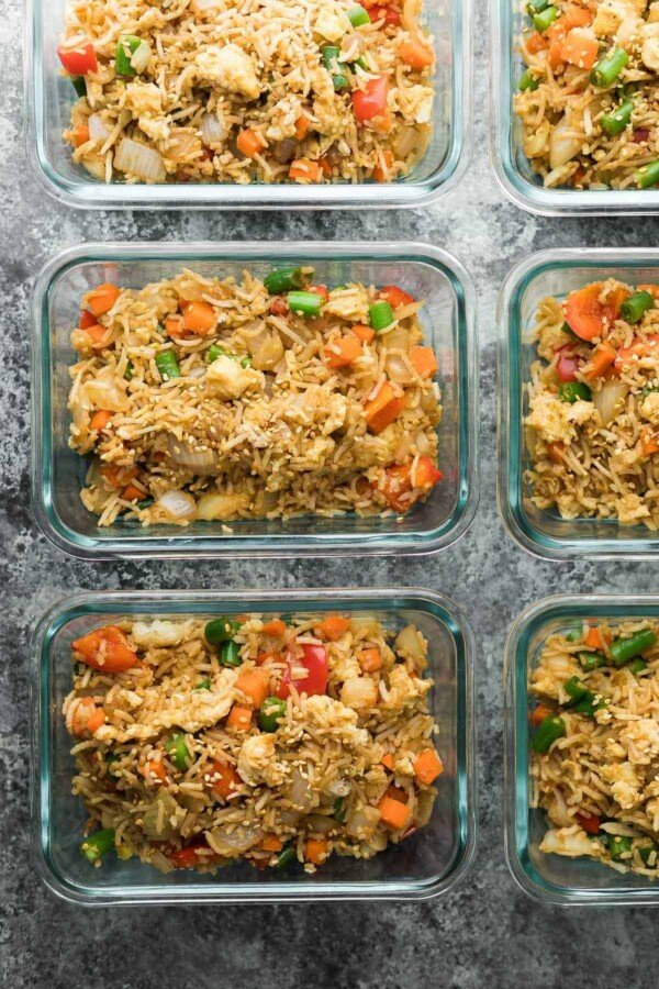 meal prep containers with fried rice lined up