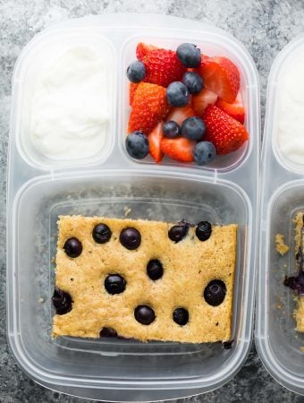 plastic container with sheet pan protein pancake fruit and yogurt