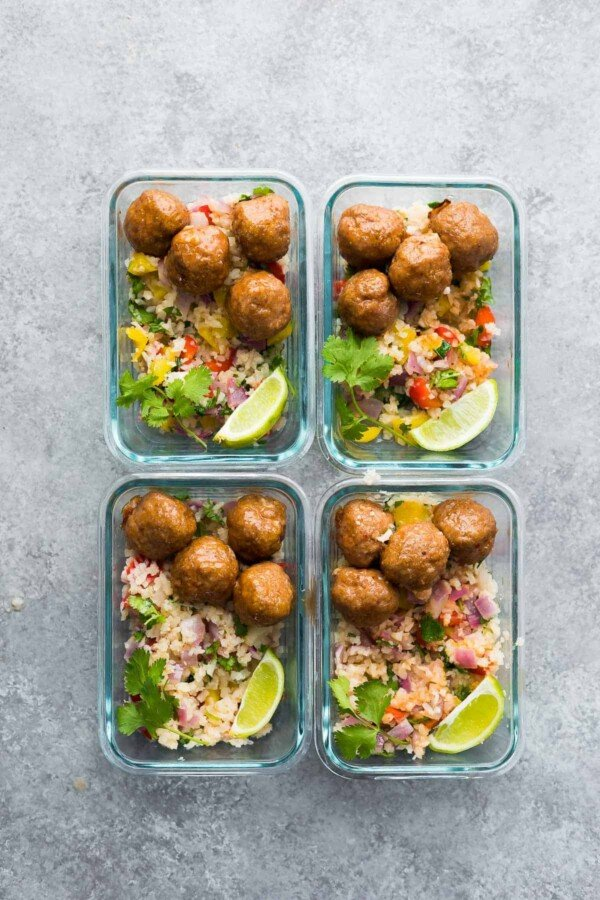 Overhead view of four glass containers with Honey Chipotle Meatball Meal Prep Bowls