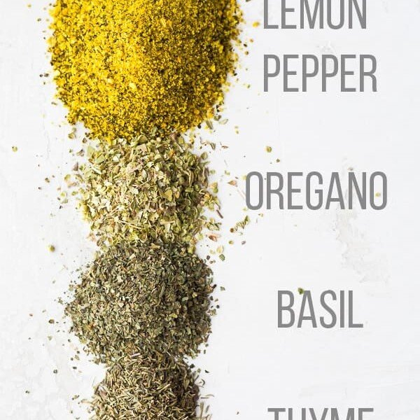 ingredients lined up for lemon herb seasoning with labels on white background