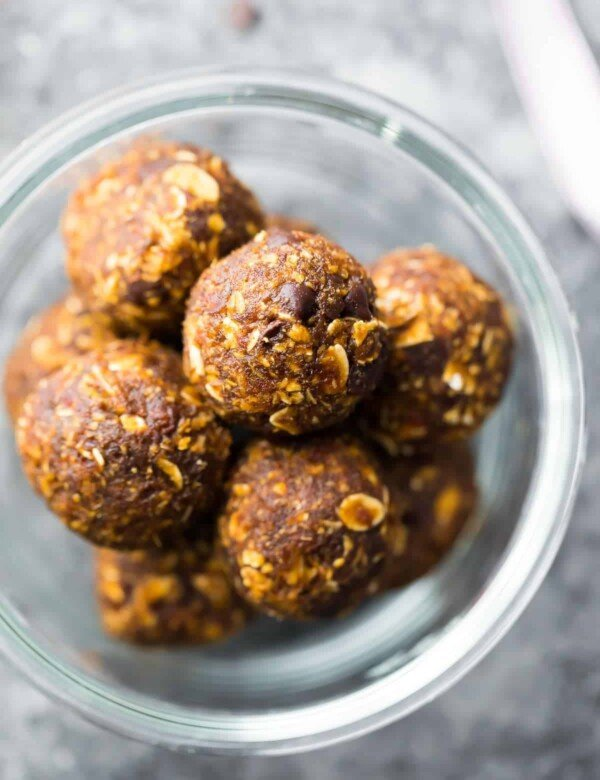 a glass bowl filled with no bake gingerbread oatmeal energy bites