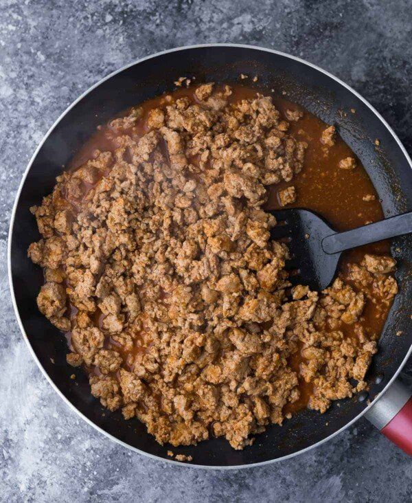 Lean ground turkey sauteed in a large pan with spatula