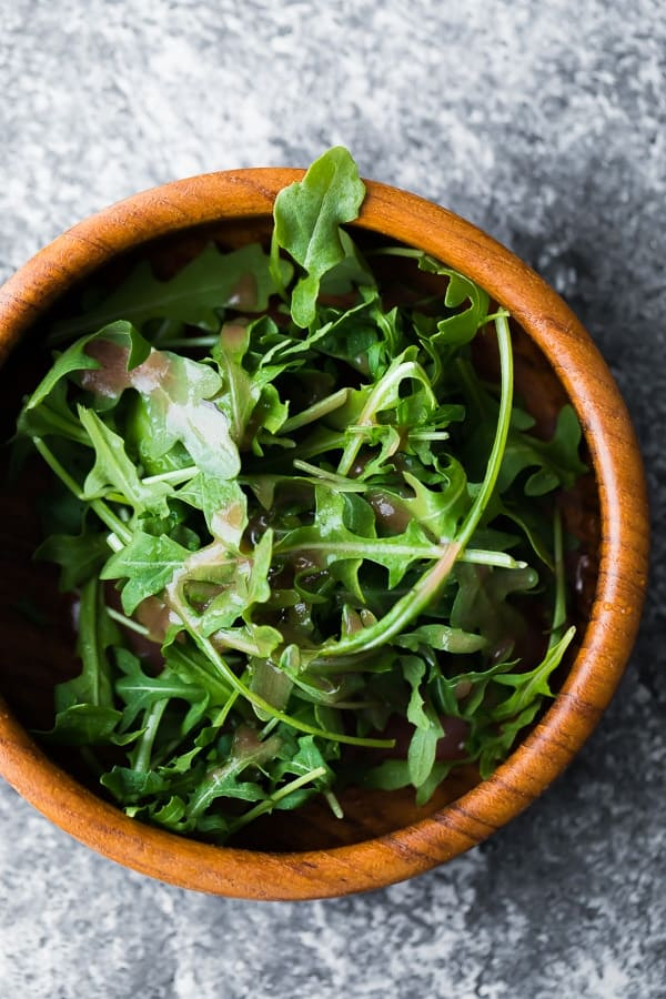 red wine vinegar dressing on a green salad