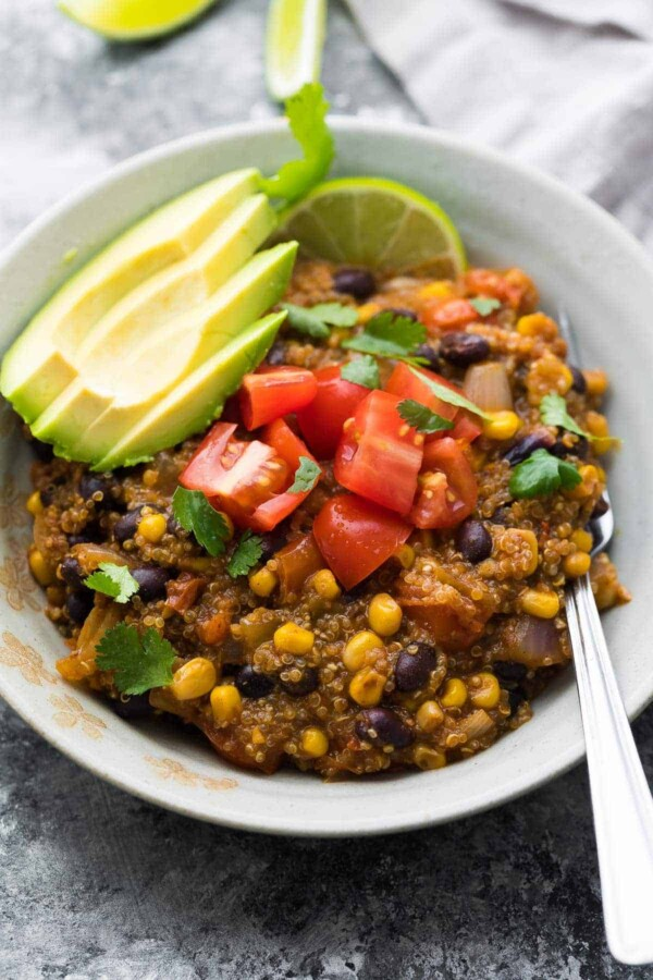 Instant Pot quinoa enchilada casserole is a delicious and easy weeknight dinner! Prep freezer packs for a convenient freezer Instant Pot meal. Vegetarian, gluten-free, and easily made vegan!