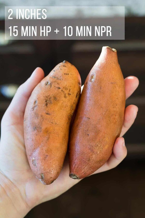 a hand holding two small sweet potatoes with the cook time indicated