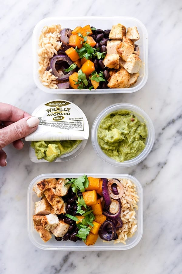 Roasted Chicken Butternut Squash and Guacamole Rice Bowls with hand opening container of guacamole