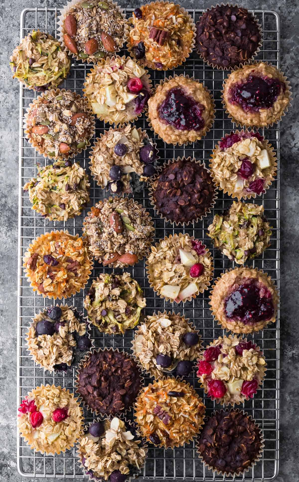 overhead shot of a variety of baked oatmeal cups on wire rack